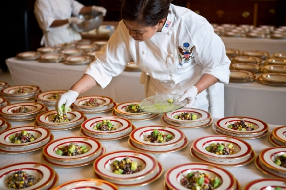 White House Executive Chef Cris Comerford plates Quinoa Black Bean and Corn Salad in the Old Family Dining Room of the White House before the Kids' State Dinner, Aug. 20, 2012. The salad was a winning recipe from Haile Thomas, 11, of Arizona. (Official White House Photo by Sonya N. Hebert)